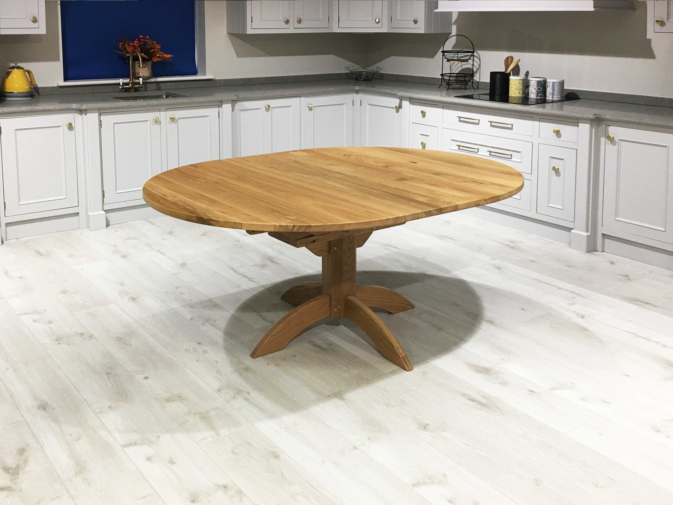Oak-Round-Flip-Top-Single-Pedestal-Table-1200-x-1200-to-1600-x-1200