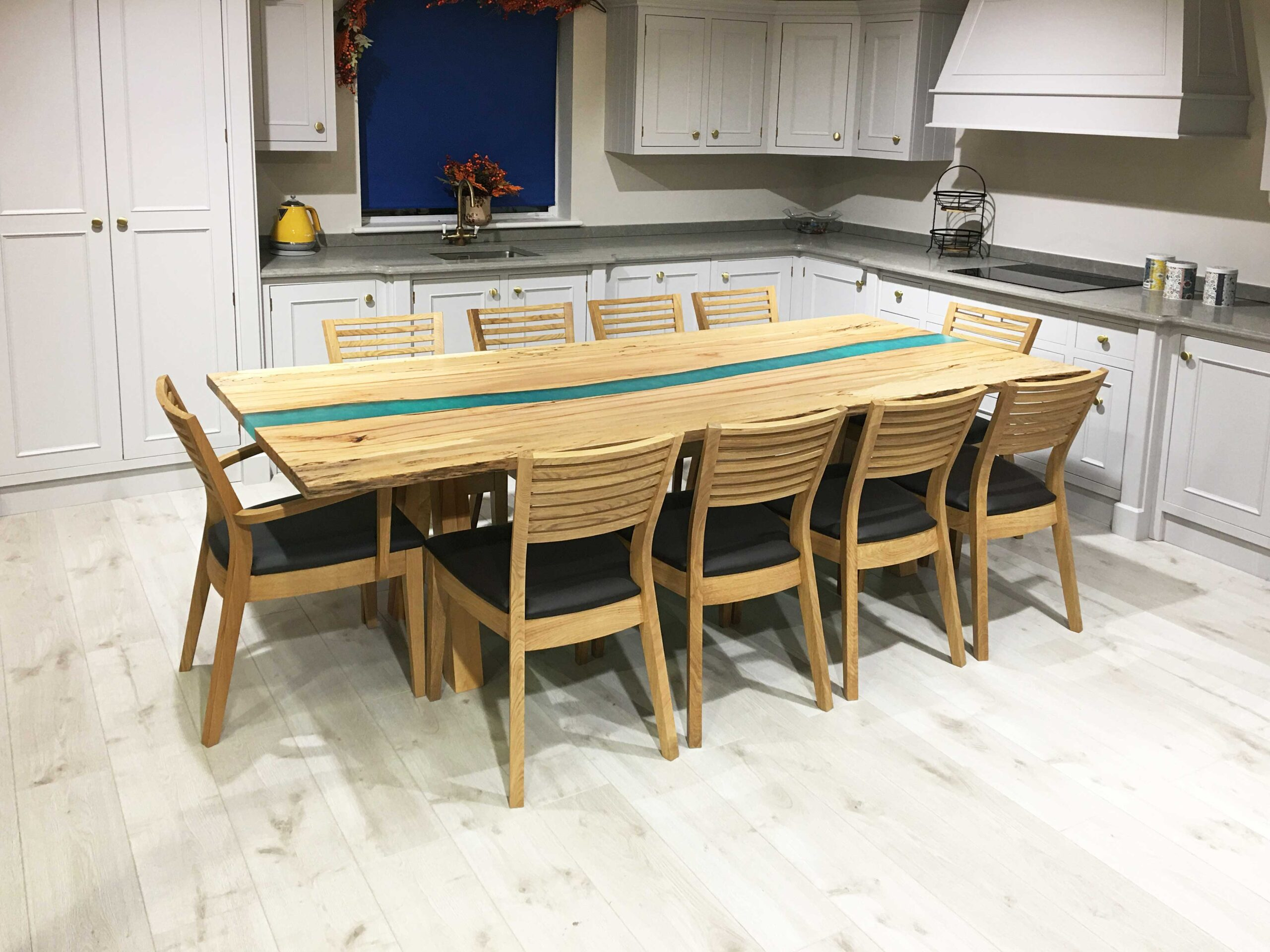 This is a stunning table made from spalted beech from a tree that came down in a storm in 2017. We love working with rescued timber, bringing the best of nature back to life and creating beautiful pieces of furniture. This table has turquoise coloured resin and solid timber legs.